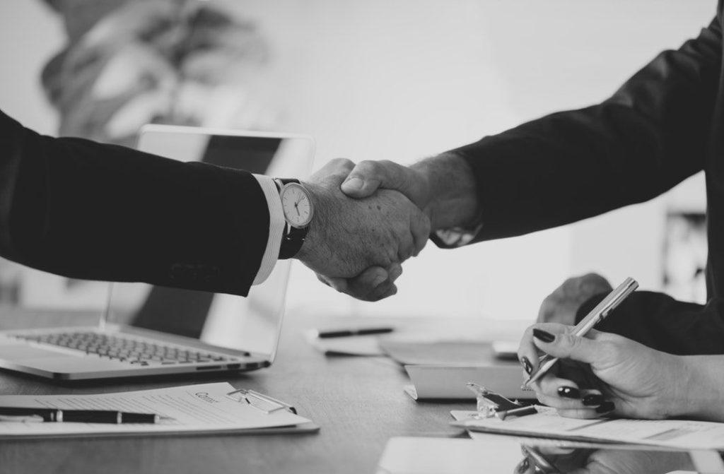tow men shaking hands, | Leasing financing company