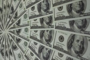 hundred dollar bills laid out in a fan | Lease Genie offers business lines of credit when you bank will not.